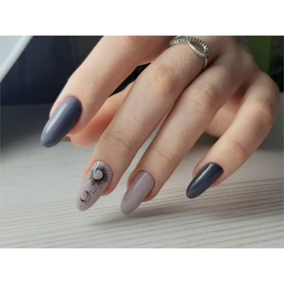 Маникюр со слайдерами в пастельных тонах на длинные ногти.