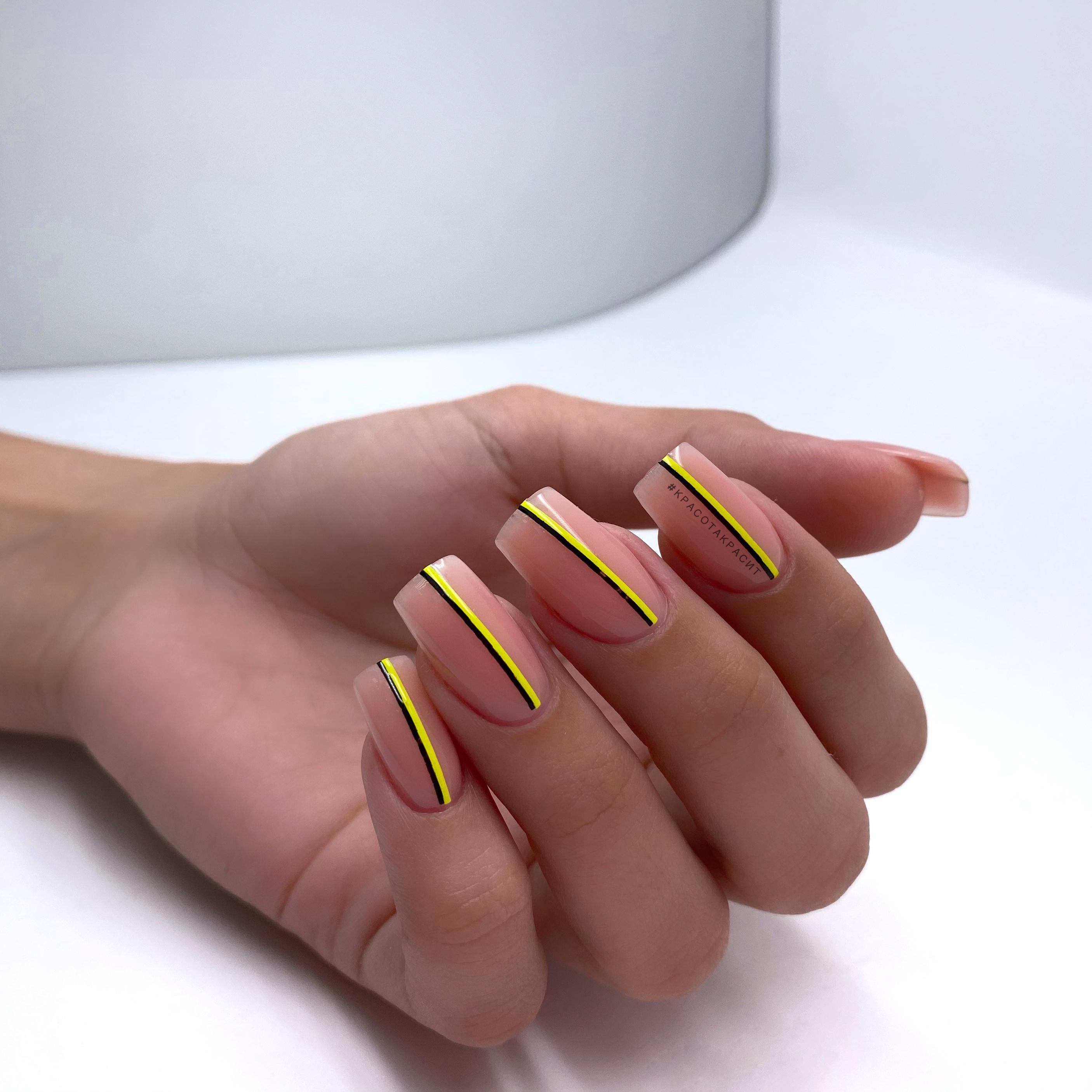 Нюдовый маникюр с цветными полосками на длинные ногти.